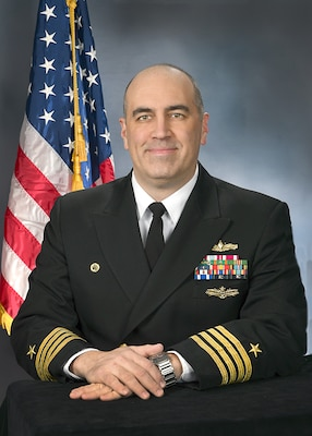 Captain Philip R. Mlynarski, USN, Commanding Officer, AEGIS Technical Representative