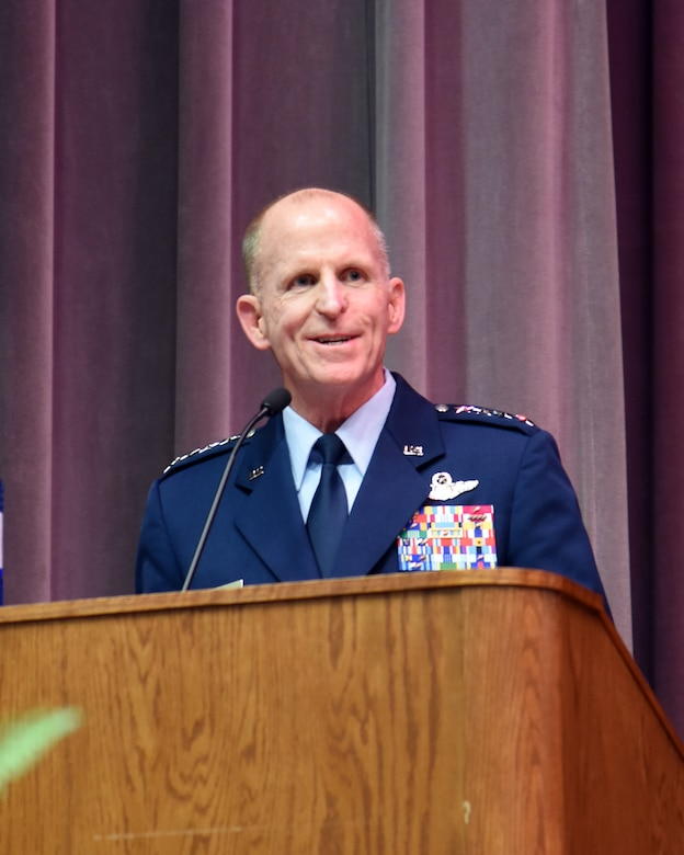 """Air Force Vice Chief of Staff Gen. Stephen Wilson speaks to the audience during the retirement ceremony for Richard """"Sonic"""" Johnson, former 14th Flying Training Wing Public Affairs chief, at the Kaye Auditorium Jan. 25, 2019, on Columbus Air Force Base, Mississippi. Wilson was the 14th FTW commander from 2004-2006, while Johnson was the public affairs chief. (U.S. Air Force photo by Melissa Doublin)"""