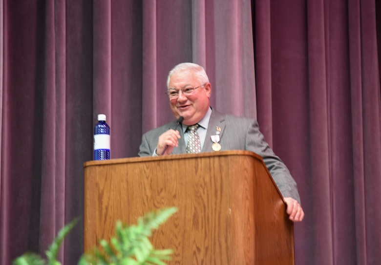 """Richard """"Sonic"""" Johnson, former 14th Flying Training Wing Public Affairs chief, addresses those in attendance during his retirement ceremony at the Kaye Auditorium Jan. 25, 2019, on Columbus Air Force Base, Mississippi. Johnson served as the 14th FTW Public Affairs chief since 2004. (U.S. Air Force photo by Melissa Doublin)"""