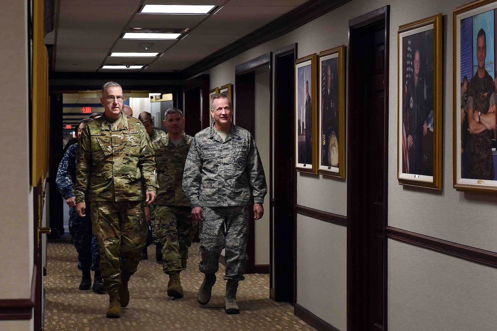 U.S. Air Force Gen. John Hyten, commander of U.S. Strategic Command (USSTRATCOM), escorts U.S. Air Force Gen. Terrence O'Shaughnessy, commander of North American Aerospace Defense Command (NORAD) and U.S. Northern Command (USNORTHCOM), through USSTRATCOM headquarters, Offutt Air Force Base, Neb., Jan. 30, 2019. During his visit, O'Shaughnessy toured the command's global operations center, battle deck and new command and control facility. He also participated in discussions with Hyten and other senior leaders on the continuing collaboration between USSTRATCOM, NORAD and USNORTHCOM. USSTRATCOM has global responsibilities assigned through the Unified Command Plan that include strategic deterrence, nuclear operations, space operations, joint electromagnetic spectrum operations, global strike, missile defense, and analysis and targeting.