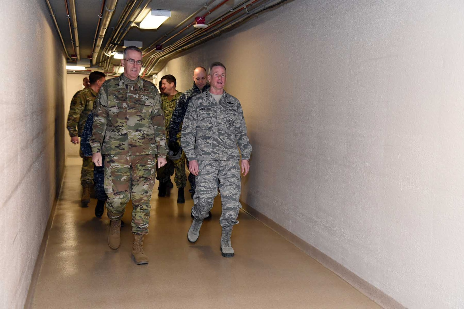 U.S. Air Force Gen. John Hyten, commander of U.S. Strategic Command (USSTRATCOM), and U.S. Air Force Gen. Terrence O'Shaughnessy, commander of North American Aerospace Defense Command (NORAD) and United States Northern Command (USNORTHCOM), descend to the USSTRATCOM Global Operations Center (GOC), Offutt Air Force Base, Neb., Jan. 30, 2019. During his visit, O'Shaughnessy toured the command's GOC, battle deck and new command and control facility. He also participated in discussions with Hyten and other senior leaders on the continuing collaboration between USSTRATCOM, NORAD and USNORTHCOM. USSTRATCOM has global responsibilities assigned through the Unified Command Plan that include strategic deterrence, nuclear operations, space operations, joint electromagnetic spectrum operations, global strike, missile defense, and analysis and targeting.