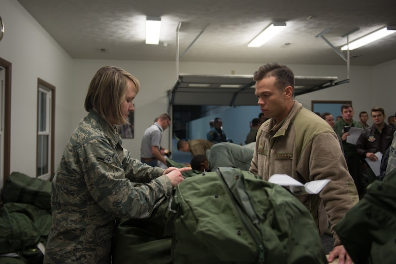 Airman Danuta Lukaszynska, 55th logistics Readiness Squadron, issues mobility bags to members of Team Offutt Jan. 29, 2019, on Offutt Air Force Base, Nebraska. The base participated in Phase I of Operational Readiness Exercise Winter Havoc. (U.S. Air Force photo by Tech. Sgt. Rachelle Blake)
