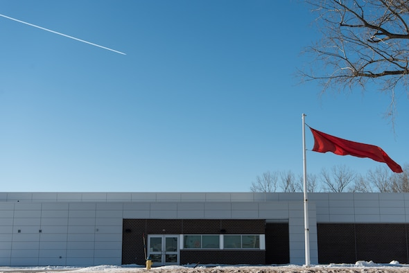 A red flag flies outside the 55th Security Forces Squadron Combat Arm shooting range Feb. 1, 2019, at Offutt Air Force Base, Nebraska. The red flag is raised to signify that the range is active and those in the area should proceed with caution. (U.S. Air Force photo by Senior Airman Jacob Skovo)