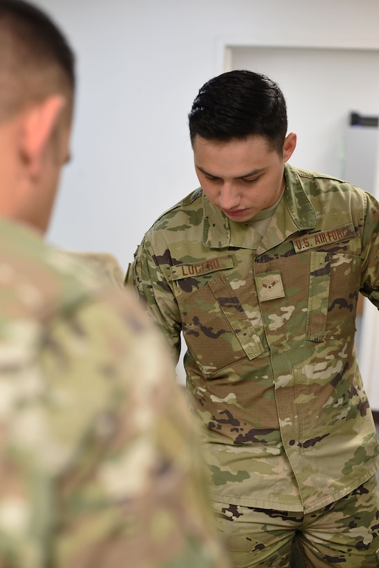 Airman 1st Class Joseph Lucero, 14th Operations Support Squadron host aviation resource manager, helps a captain with flight records Jan. 30, 2019, on Columbus Air Force Base, Mississippi. The 14th OSS host aviation resource management (HARM) office will in process students and out process graduated U.S. Air Force pilots. (U.S. Air Force photo by Airman 1st Class Keith Holcomb)
