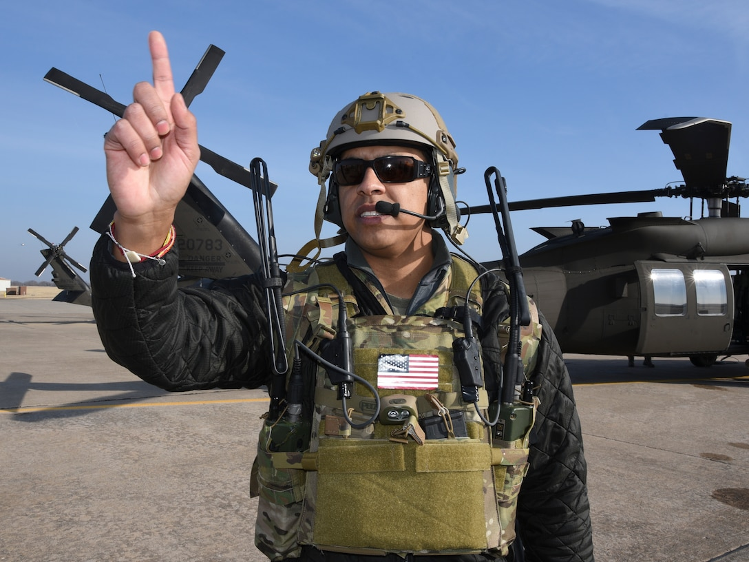 Staff Sgt. Kevin Shears, a Joint Terminal Attack Controller instructor with the 137th Special Operations Wing, Oklahoma Air National Guard, selects trainees to board an Oklahoma Army National Guard UH-60M Black Hawk at Tinker Air Force Base during SENTRY REX 19-01 exercise on Jan. 15.