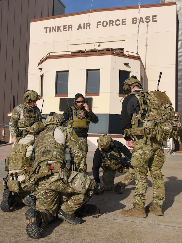 Joint Terminal Attack Controllers of the 137th Special Operations Wing, Oklahoma Air National Guard, review assault plans on the concrete in front of Tinker Air Force Base Operations building during a SENTRY REX 19-01 training mission on Jan. 15.