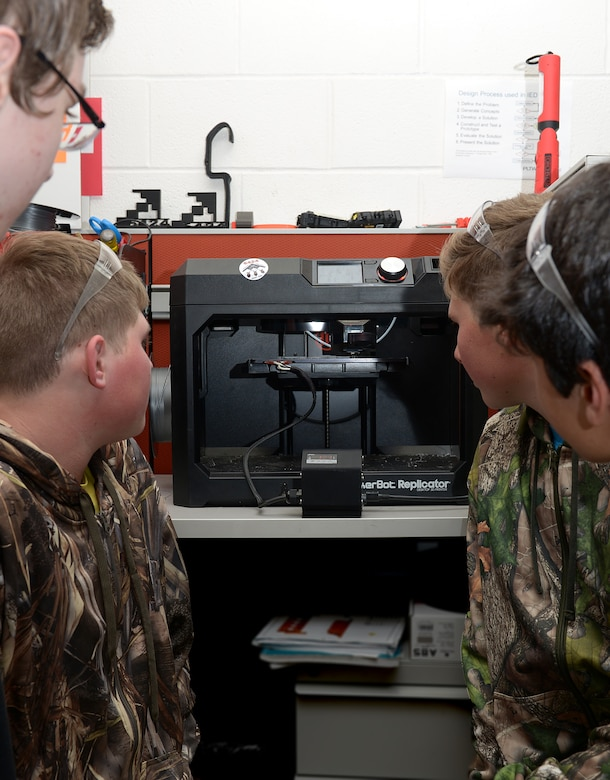 Students on the Knob Noster High School robotics team designed a protective panel that covers four switches in the cockpit of the $2.2 billion B-2 Stealth Bomber. Each panel costs $1.25 to produce. A four-switch panel called the airframe mounted accessory drive, or AMAD, sits on the left side of the B-2's two-person cockpit. The AMAD switches control the connection of the engines to the hydraulic and generator power of the aircraft. (U.S. Air Force photo by Staff Sgt. Kayla White)