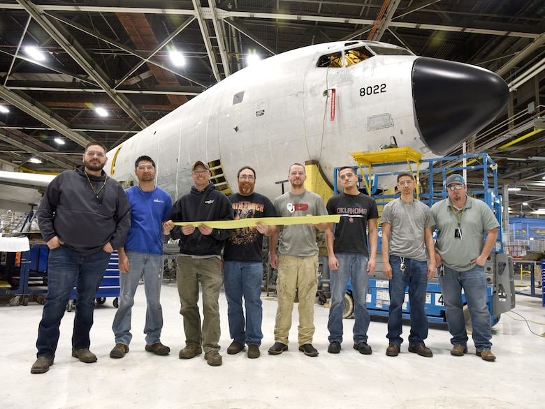 From left, Justin Herndon, Jaime Espinoza, Robert Ingraham, David Matthis, Tyler Smith, Linn Deer, Isaac Leija, Justin Henthorn and Russell Strangfeld (not pictured) made up the team of 564th Aircraft Maintenance Squadron sheet metal mechanics who worked to remove and reattach the keel beams from each of the KC-135 Stratotankers. (U.S. Air Force photo/Kelly White)