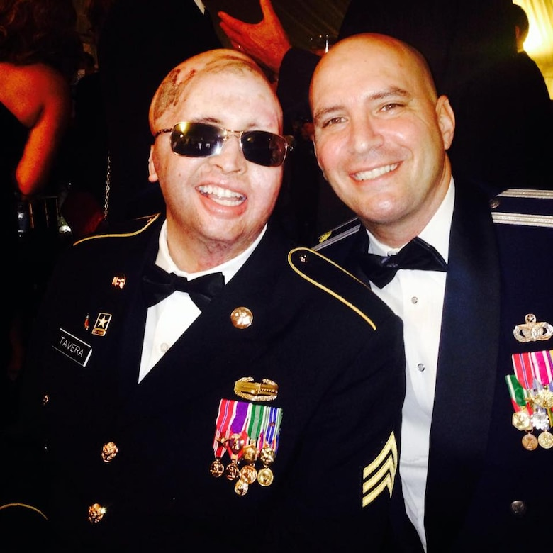 Air Force Lt. Col. Kevin Lombardo, 341st Missile Security Forces Squadron commander, then Maj. Lombardo, right, poses for a photo with Army Sgt. Joel Tavera at a military ball.