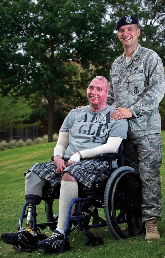 Air Force Lt. Col. Kevin Lombardo, 341st Missile Security Forces Squadron commander, then Capt. Lombardo, right, poses for a photo with Army Spc. Joel Tavera.