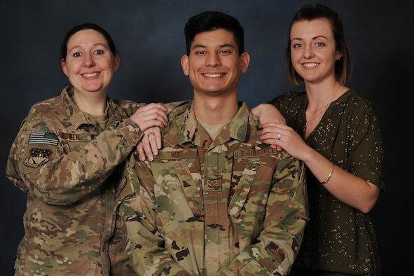 Senior Airman Christopher Wy, 341st Security Forces Support Squadron convoy response force lead, center, poses for a photo with Staff Sgt. Elizabeth Bowen, 341st SSPTS CRF team leader, left, and Senior Airman Cassi Dornon, 341st SSPTS CRF team member Jan. 16, 2019, at Malmstrom Air Force Base, Mont. Dornon and Bowen helped their wingman with a tough life situation.