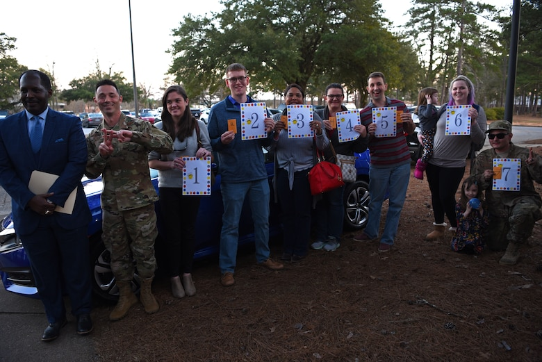 The final seven Team Shaw members in the raffle to win a free car wait in order to try their car key during a Smile Campaign car giveaway wrap-up party at Shaw Air Force Base, S.C., Jan. 31, 2019.