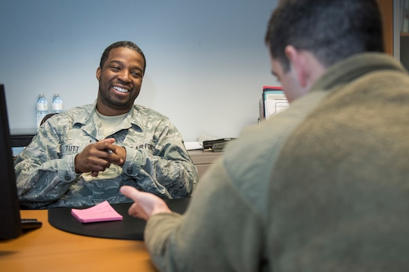Master Sgt. Hakim Tutt, 514th Air Mobility Wing in-service recruiter, speaks with an active-duty airman about the benefits of the Air Force Reserve