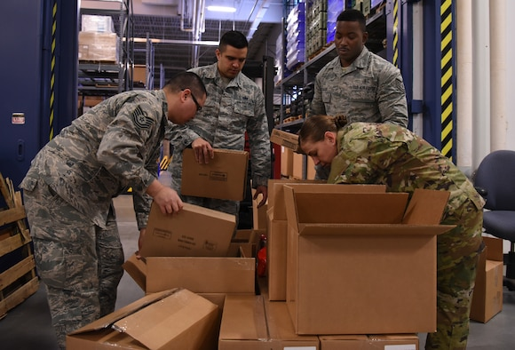 Airmen organize donations provided by the Denver USO Jan. 28, 2019, at F. E. Warren Air Force Base, Wyo. The care packages are part of the USO2GO initiative, where snacks are transported to missile alert facility sites to boost morale for Airmen in the field. (U.S. Air Force photo by Tech. Sgt. Ashley Manz)