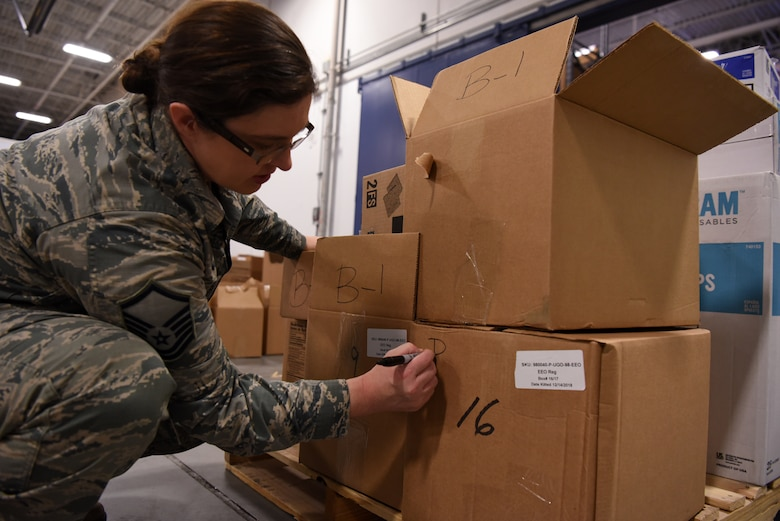 Master Sgt. Tina Bakker, 90th Force Support Squadron Missile Alert Facility Feeding Operations flight chief, writes site locations on packages Jan. 28, 2019, at F. E. Warren Air Force Base, Wyo. The care packages are part of the USO2GO initiative, where snacks are transported to missile alert facility sites to boost morale for Airmen in the field. (U.S. Air Force photo by Tech. Sgt. Ashley Manz)