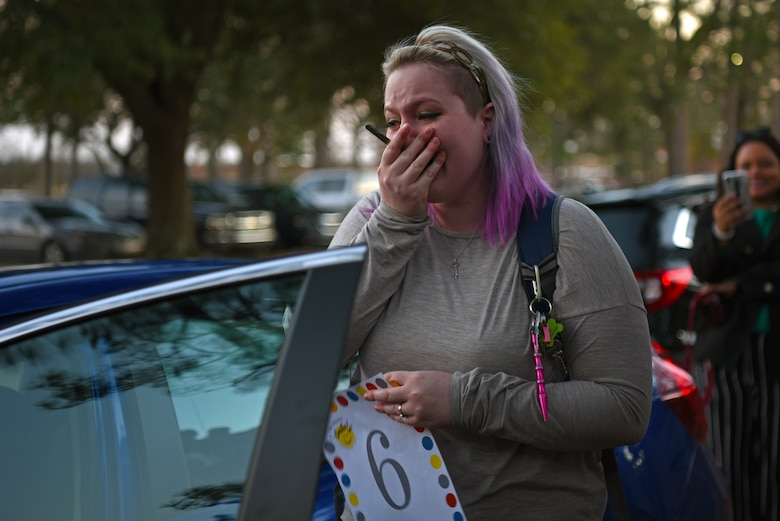 Staci Farland, Team Shaw spouse, opens the door of the free car during a Smile Campaign car giveaway wrap-up party at Shaw Air Force Base, S.C., Jan. 31, 2019.