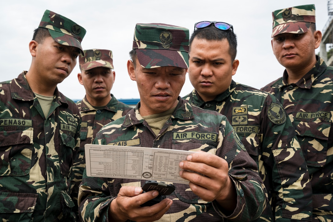 Philippine Air Force 950th Communications, Electronics and Information Systems Group communication personnel practice using a pocket transit and slide rule to align satellite during Bilateral Air Contingent Exchange-Philippines (BACE-P) at Cesar Basa Air Base, Philippines, January 30, 2019.
