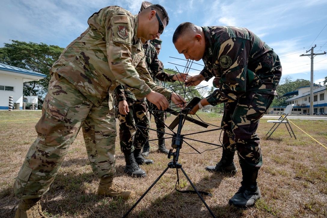 U.S. Air Force Master Sgt. Roger Ramos, a communication planner with Pacific Air Forces (PACAF) Directorate of Air and Cyberspace Operations, works with Philippine Air Force Capt. Genimar Javier, commander, 547th Communications Electronic Informations Systems Squadron, to set up a tactical satellite antenna during Bilateral Air Contingent Exchange-Philippines (BACE-P) at Cesar Basa Air Base, Philippines, January 30, 2019.