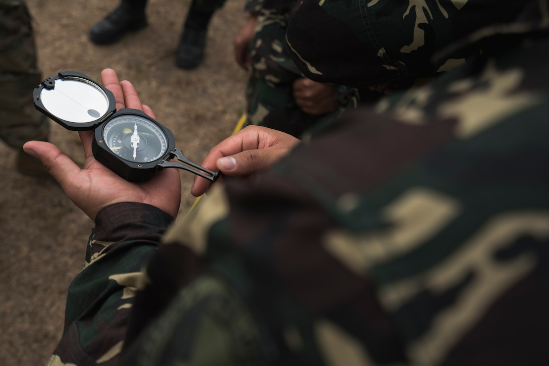 A Philippine Air Force communication specialist from the 950th Communications, Electronics and Information Systems Group practices using a pocket transit to align satellites during Bilateral Air Contingent Exchange-Philippines (BACE-P) at Cesar Basa Air Base, Philippines, January 30, 2019.