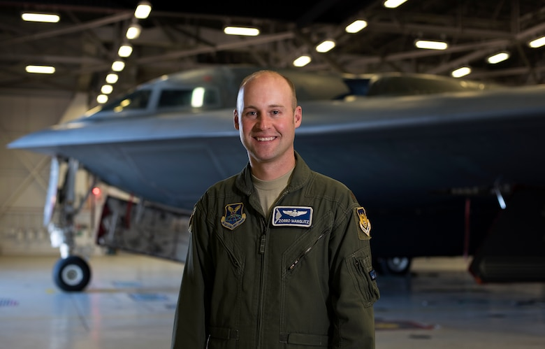 "U.S. Air Force Maj. Joseph Manglitz, a B-2 evaluator pilot at Whiteman Air Force Base, Missouri, was one of the Airmen who worked closely with the high school students, guiding them in their design and printing processes of the protective panels for the aircrafts' cockpits. ""It was impressive to see the ingenuity and the initiative in each of these students,"" Manglitz said. (U.S. Air Force photo by Staff Sgt. Kayla White)"