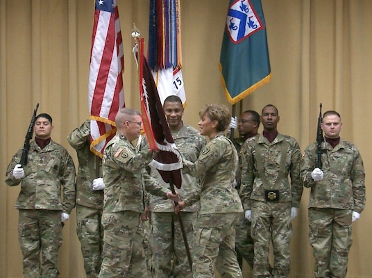 Lt. Gen. Nadja Y. West, The Surgeon General of the U.S. Army and commander, Army Medical Command (right), passes the colors to Lt. Gen. Michael D. Lundy, Commander, Combined Arms Center and Fort Leavenworth, Kansas, while Maj. Gen. Patrick D. Sargent, commanding general, the AMEDDC&S HRCoE (center), looks on.