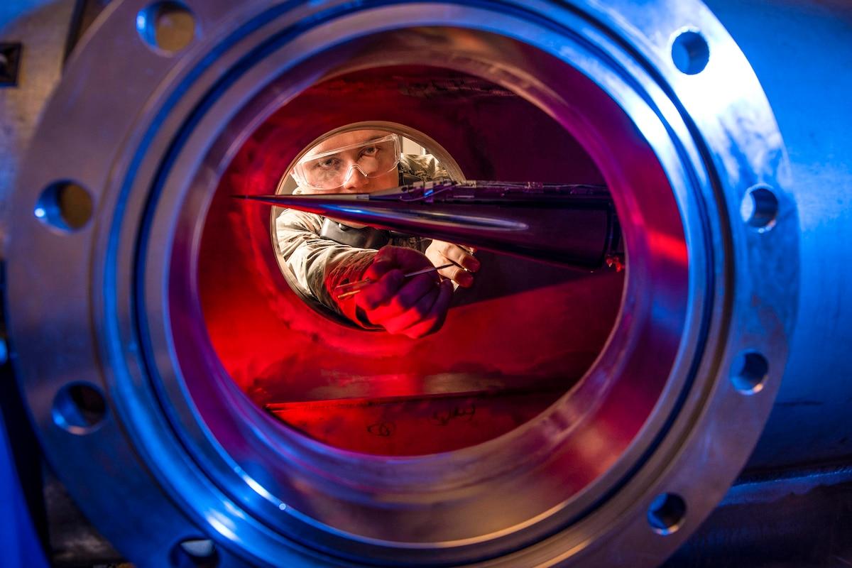 An Air Force cadet looks through a tube.