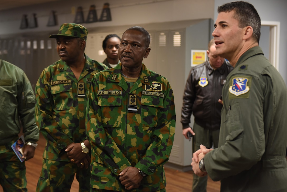 Air Vice-Marshal Aliyu Bello, director of training for the Nigerian Air Force, center, speaks with Lt. Col. Nathan Smith, 50th Flying Training Squadron commander Jan. 23, 2019, on Columbus Air Force Base, Mississippi. Bello and his team visited Columbus AFB to see how their student pilot was progressing in her training. (U.S. Air Force photo by Senior Airman Beaux Hebert)