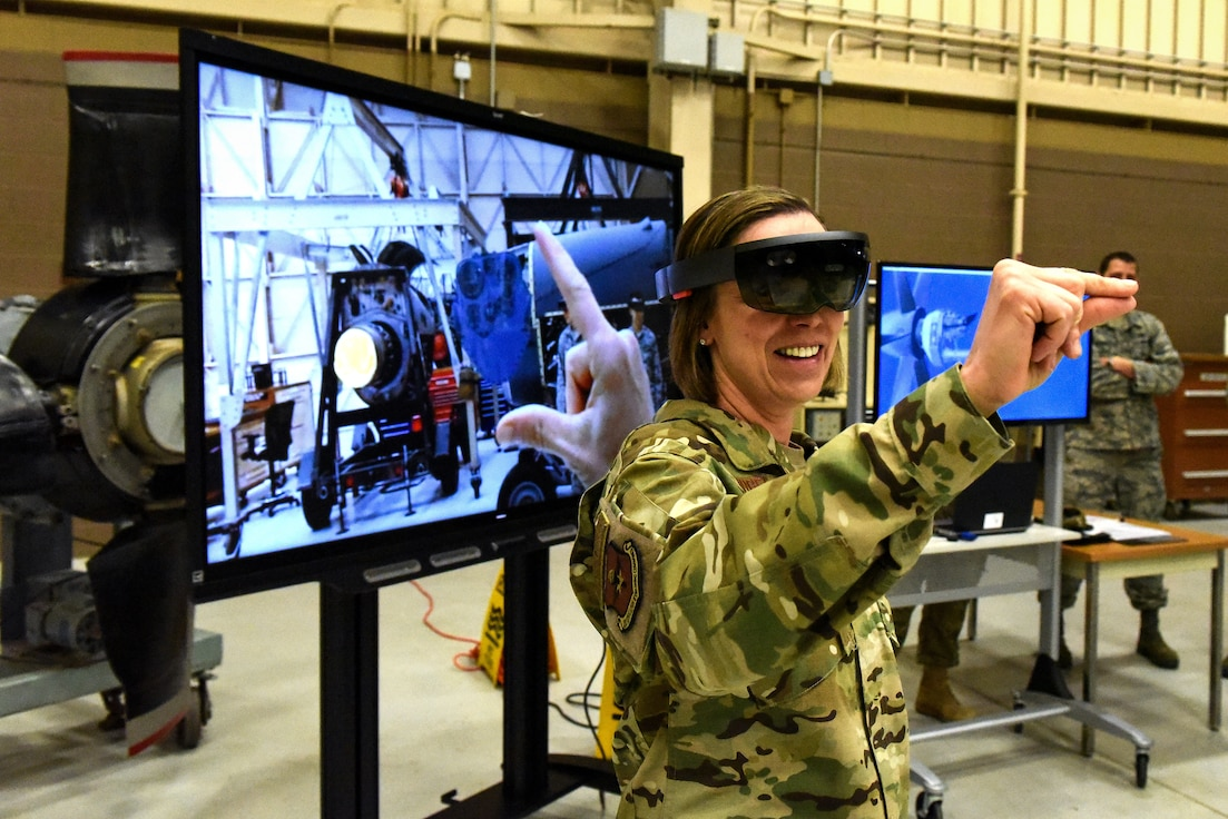Air Education and Training Command Command Chief Master Sgt. Juliet Gudgel uses augmented reality goggles used for enhance aircraft engine maintenance training at the 361st Training Squadron during a visit to Sheppard Air Force Base, Texas, Jan. 31, 2019. The chief said Sheppard is on the leading edge of using such technology in technical and pilot training, part of the innovation initiative encouraged by AETC. (U.S. Air Force photo by John Ingle)