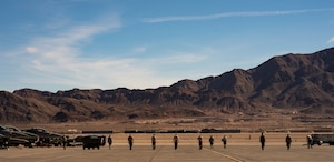 U.S. Airmen assigned to the 20th Aircraft Maintenance Squadron, 79th Aircraft Maintenance Unit, perform a foreign object and debris (FOD) walk during Exercise Red Flag 19-1 at Nellis Air Force Base, Nev., Jan. 28, 2019. FOD walks help clear the runway of any objects that may cause harm to pilots and aircraft. (U.S. Air Force photo by Senior Airman Christopher Maldonado)