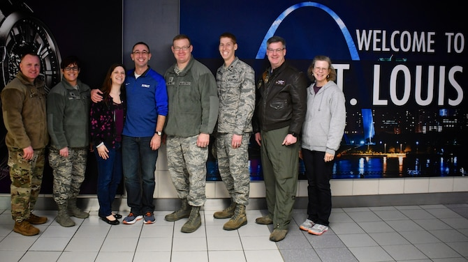 Several 932nd Airlift Wing members got out on a cold evening and welcomed back returning Airmen recently, including deployer and unit Chaplain (Maj.) Michael Williams, in blue shirt. He was greeted with applause, hugs and verbal greetings of appreciation upon his arrival back in Illinois on January 27, 2019.  Various members of the wing staff, public affairs, medical, family readiness and operations were represented. Although tired from the long trip back, the chaplain expressed gratitude and thankfulness to those on hand.  The 932nd AW is a 22nd Air Force unit flying the C-40 aircraft under Air Force Reserve Command and is located at Scott Air Force Base, Illinois.  Citizen Airmen like Maj. Williams come from 37 different states to train with the 932nd AW.  (U.S. Air Force photo by Lt. Col Stan Paregien)
