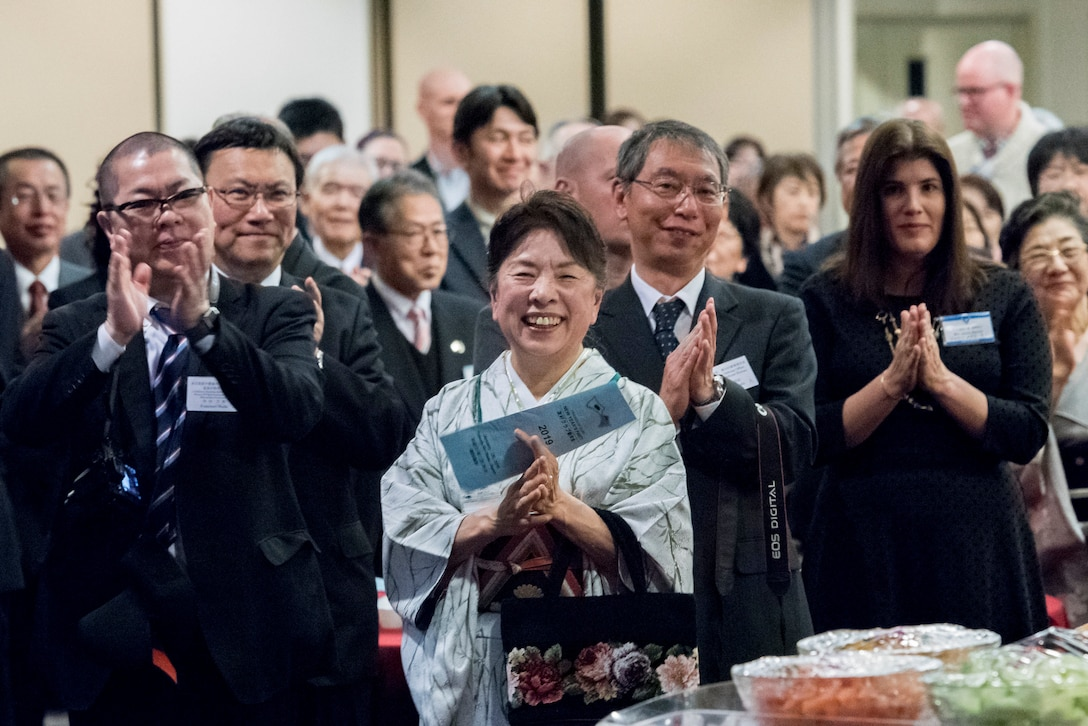 Audience members applause after a new years greeting given by Col. Otis C. Jones, 374th Airlift Wing commander, during the U.S.-Japan Joint New Year's Party at Yokota Air Base, Japan, Jan. 26, 2019.