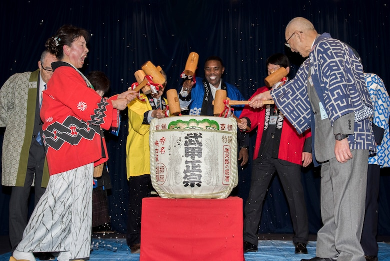 Col. Otis C. Jones, 374th Airlift Wing commander, breaks open a sake keg along with the seven friendship club presidents during the Kagami-biraki ceremony at Yokota Air Base, Japan, Jan. 26, 2019.