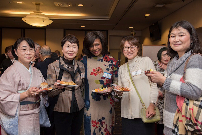 Nataki Jones, wife of Col. Otis C.Jones, 374th Airlift Wing commander, poses for a photo with members of Ome-Yokota Friendship Club during the U.S.-Japan Joint New Year's Party at Yokota Air Base, Japan, Jan. 26, 2019.