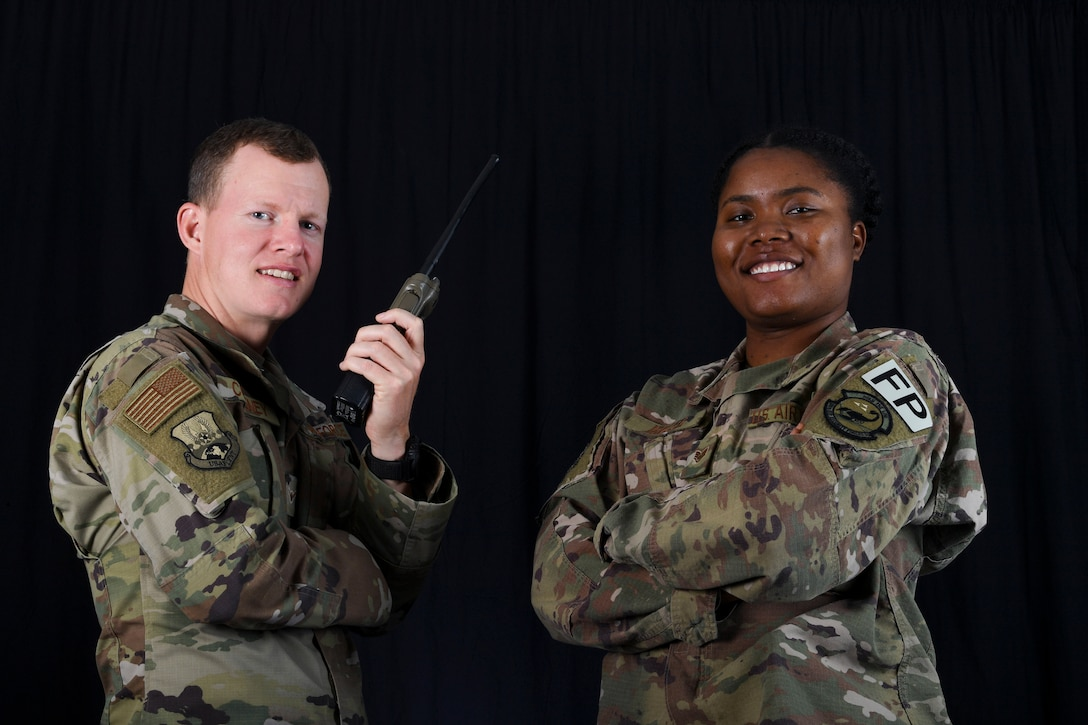 Protection personnel Amn Michael Coveney and Staff Sgt. Aneke Miller pose for a photo at Al Dhafra Air Base, United Arab Emirates, Jan. 31, 2019.