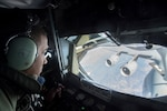 New Jersey Air National Guard Staff Sgt. Vince Stokes, a boom operator with the 141st Air Refueling Squadron, refuels a C-17 Globemaster III from Joint Base Charleston, S.C., over the continental U.S., Jan. 28, 2019. The KC-135R Stratotanker from Joint Base McGuire-Dix-Lakehurst, N.J., is flown by the 141st ARS from the 108th Wing.