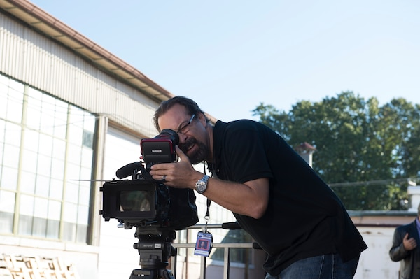 EMC Producer-Director Robert Stephens checks a scene through the camera eyepiece at Fort Eustis, Virginia, Oct. 17, 2014. Stephens was working on a production for the U.S. Army Safety Center at Fort Rucker, Alabama. (U.S. Army photo by Chris Thompson)