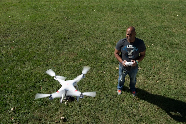 U.S. Army Enterprise Multimedia Center Videographer and FAA-licensed Drone Operator Dominic Davis captures footage during filming of the U.S. Army Surgeon General's Performance Triad campaign at Fort Eustis, Virginia, Oct. 17, 2014.