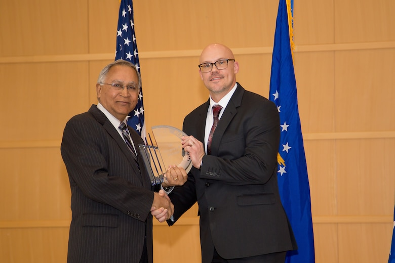 Dr. Gregory Yandek (right) from Edwards Air Force Base, California, was on hand to accept the Don Ross Award from Dr. Siva Banda (left), chief scientist, Aerospace System's Directorate. This award recognizes a culmination, multi-year outstanding scientific or engineering achievement in space, science and technology. The directorate held their annual awards ceremony Jan. 24. (U.S. Air Force photo/Danielle DeBorde)