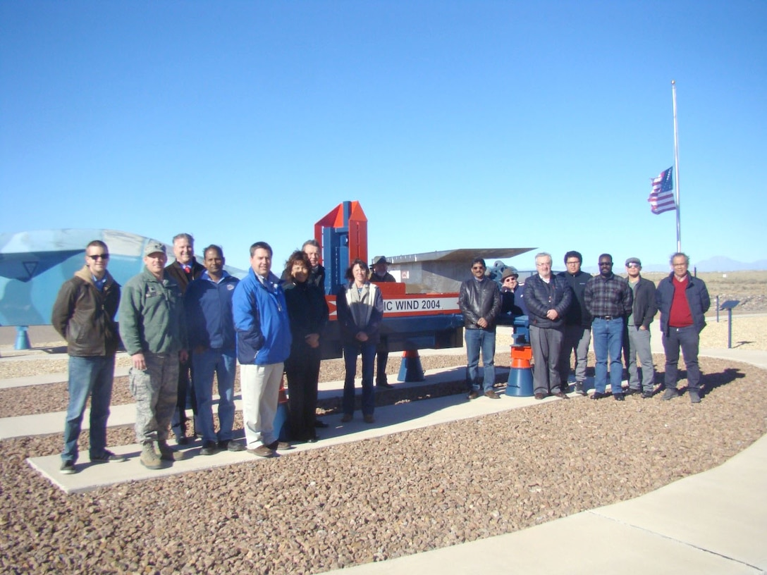 The 704th Test Group's Holloman High Speed Test Track, operated by the 846th Test Squadron, recently hosted a group of scientists and engineers from the University of Texas at El Paso (UTEP) at Holloman Air Force Base, New Mexico. The 704th Test Group leadership and staff from UTEP used this visit as an opportunity to discuss ways the two groups could collaborate. Pictured from left are Bryan Sinkovec, Lt. Col Mathew Wroten, Commander 846 TS; Robert Kirken, dean, College of Science at UTEP; Vinod Kumar; Robert Edmonds; Theresa Maldonado, dean, College of Engineering at UTEP; Bob Currey; Michelle Zeisset; Gregory Mckinzey; Ramana Chintalapalle; Thomas Gill; Carlos Ferregut; Arturo Rodriguez; Richard Adansi; Jose Terrazas; and Eduardo Quinonez-Rico. (Courtesy photo)