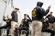Soldiers assigned to the 86th Engineer Dive Detachment signal that they are prepared to perform their individual roles during dive supervisor training and qualification near Kuwait Naval Base, Kuwait, Jan. 22, 2019. The Soldiers operate as a team to ensure the divers accomplish their mission as safely as possible.