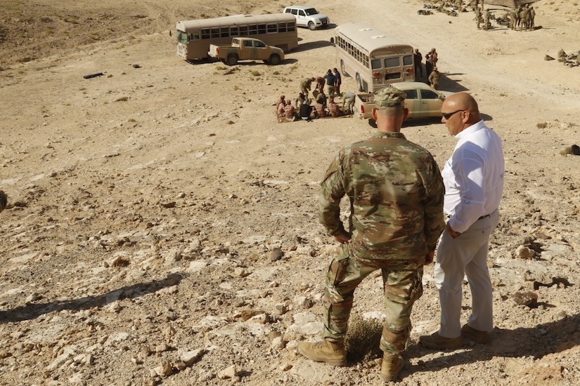 Command Sgt. Maj. Joseph Cornelison, Senior Enlisted Advisor for United States Army Central, more commonly known as ARCENT, speaks with an exercise planner for Inferno Creek 19 as they overlook a break in training in Rabkoot, Oman, Jan. 28, 2019. The U.S. Army and the Royal Army of Oman are spending days in a wadi system conducting team, squad, and platoon maneuvers during exercise Inferno Creek 19. The bilateral exercise was designed to strengthen relations between the two militaries. It is an opportunity for both militaries to build tactical proficiency and gain shared understanding of each other's forces and support long-term regional stability.