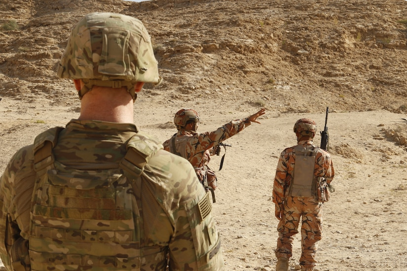 A team leader from 2nd Battalion, 198th Armored Regiment, 155th Armored Brigade Combat Team, Mississippi National Guard, observes Omani troops as they conduct squad movements through a wadi in Rabkoot, Oman, Jan. 28, 2019. 'Wadi' translates to 'valley' from Arabic to English. The U.S. Army and the Royal Army of Oman are spending days in a wadi system conducting team, squad, and platoon maneuvers during exercise Inferno Creek 19. The bilateral exercise was designed to strengthen relations between the two militaries. It is an opportunity for both militaries to build tactical proficiency and gain shared understanding of each other's forces and support long-term regional stability.