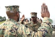 LOGCOM Marine receives promotion, medal