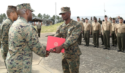 LOGCOM Marine receives promotion, medal