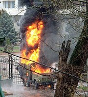An opposition-captured vehicle burns near the capitol building during citywide protests and riots in Bishkek, Kyrgyzstan on April 7, 2010.