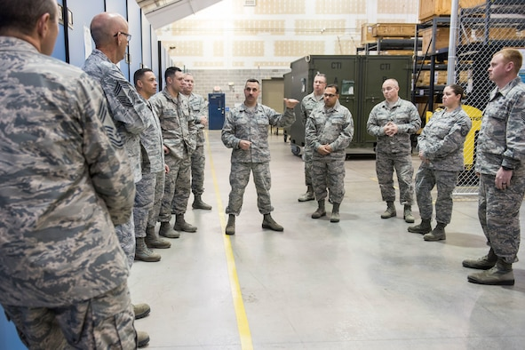 Master Sgt. Jim DeCicco, center, support section supervisor for the 167th Logitics Readiness Squadron, discusses supply processes at the 167th Airlift Wing, Jan. 16, 2019, during a Material Management Advisory Group Region 2 meeting  held at the 167th AW. (U.S. Air National Guard photo by Senior Master Sgt. Emily Beightol-Deyerle)