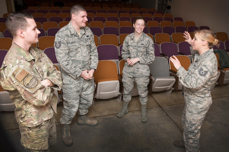 Officers for the 167th Airlift Wing's Rising Six Council, left to right, Tech. Sgt. Geoffrey Blankenship, Tech. Sgt. Jacob Bixler, Staff Sgt. Kayla Hoffmaster and Tech. Sgt. Jessica Hughes, discuss some of their ideas for the council this year. (U.S. Air National Guard photo by Senior Master Sgt. Emily Beightol-Deyerle)
