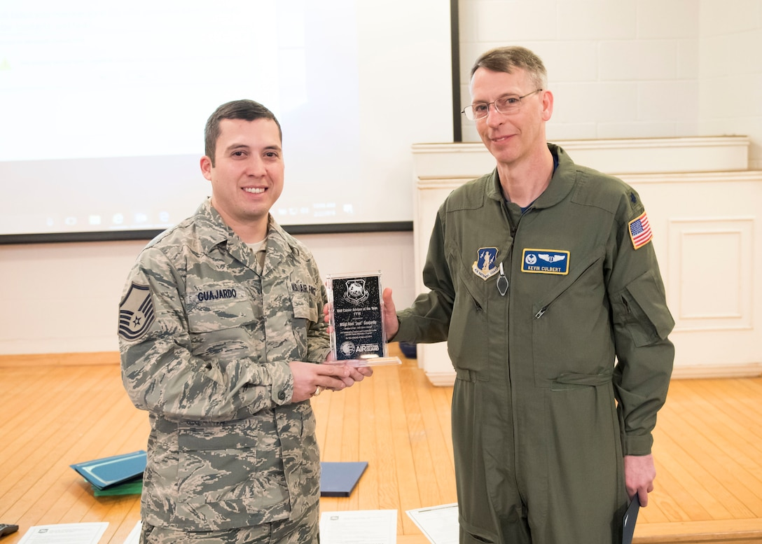 Lt. Col. Kevin Culbert, 167th Medical Group commander, presents Master Sgt Abel Guajardo with the 2018 Unit Career Advisor award during the February unit training assembly at the 167th Airlift Wing, Martinsburg, W.Va.  The award is presented for outstanding support and contribution to the 167th Career Motivation Program. (Unit career advisors aid commanders and recruiting in their retention efforts while also playing a big role in developing new airmen and assisting them in their path to a successful career. (U.S. Air National Guard photo by Tech. Sgt. Mike Dickson)