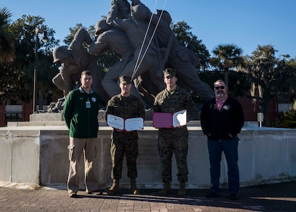 U.S. Marine Corps Staff Sgt. Trai Lockard, a data staff non-commissioned officer with 6th Marine Corps District, and Cpl. Christian Dominguez, a data non-commissioned officer with 6th MCD, pose for a photo after their reenlistment ceremony aboard Marine Corps Recruit Depot Parris Island, South Carolina, Feb. 4, 2019. Dominguez, a native of Allenton, Michigan, has currently served four years in the Marine Corps. Lockard, a native of Statesville, North Carolina, has currently served seven Years in the Marine Corps. (U.S. Marine Corps photo by Lance Cpl. Jack A. E. Rigsby)