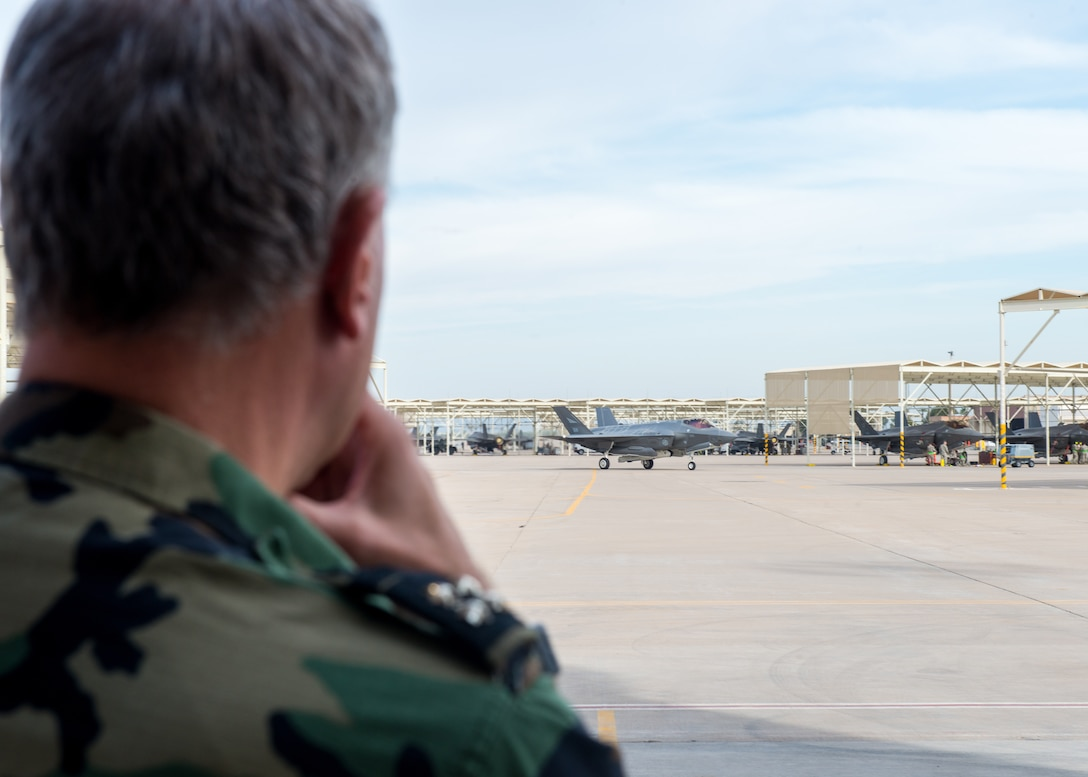 Netherlands Chief of Defense, Lieutenant Admiral Rob Bauer, observes an F-35A Lightning II taxing at Luke Air Force Base Ariz. Jan 30, 2019. The Netherlands is one of 10 nations that trains alongside US pilots in the F-16 and F-35 at Luke AFB. (U.S Air Force photo by Airman 1st Class Jacob Wongwai)